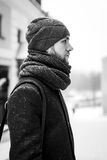 Outdoor portrait of handsome man in gray coat. Fashion photo. Beauty winter snowfall style. Black and White.  Royalty Free Stock Images