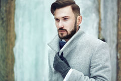 Outdoor portrait of handsome man in gray coat Royalty Free Stock Images