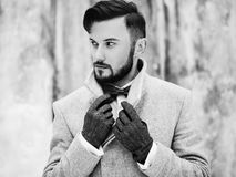 Outdoor portrait of handsome man in gray coat Stock Photo