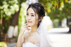 Outdoor portrait of happy asian bride stock photo