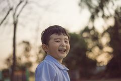 Outdoor portrait of a happy Asian student kid in school uniform smiling. With copy space for add text or word royalty free stock photos