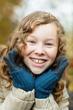 Outdoor portrait of happy blond girl. Outdoor portrait of smiling blond girl in autumn park Royalty Free Stock Photo