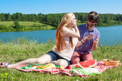 Outdoor portrait of happy loving couple at the lake, which is ea Royalty Free Stock Photo