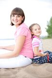 Outdoor portrait of happy mother and her daughter Stock Photo