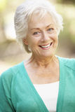 Outdoor Portrait Of Happy Senior Woman Stock Photo