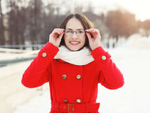 Outdoor portrait of happy smiling woman in glasses Stock Image