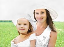 Outdoor portrait of happy smiling young woman and little girl Royalty Free Stock Images
