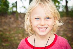 Outdoor portrait of a happy young boy. Close-up ortrait of a happy young boy outdoors Royalty Free Stock Photo