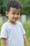 Outdoor portrait head shot of asian children smiling face lookin Royalty Free Stock Image