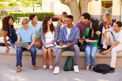 Outdoor Portrait Of High School Students On Campus. Looking At Each Other Smiling Stock Photos