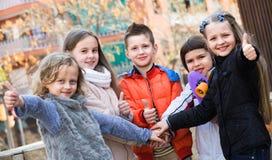 Outdoor portrait of junior school kids Stock Photography