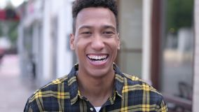 Outdoor portrait of laughing young african man stock video