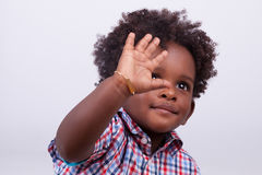 Outdoor portrait of a little african american boy - Black - chil. Outdoor portrait of a little african american boy, isolated on grey background - Black Royalty Free Stock Photo