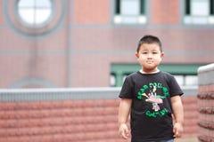 Little asian boy. Outdoor portrait of a little asian fat boy royalty free stock image