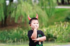 Little asian boy. Outdoor portrait of a little asian fat boy,nPlay in the park stock images