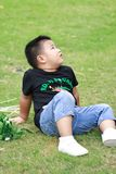 Little asian boy. Outdoor portrait of a little asian fat boy,nPlay in the park royalty free stock photography