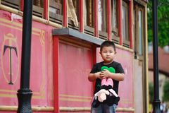 Little asian boy. Outdoor portrait of a little asian fat boy, Play in the park royalty free stock photography
