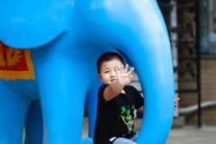 Little asian boy. Outdoor portrait of a little asian fat boy, Play in the park royalty free stock image