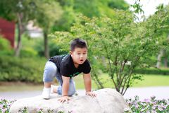 Little asian boy. Outdoor portrait of a little asian fat boy,Play in the park stock photography