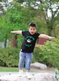 Little asian boy. Outdoor portrait of a little asian fat boy,Play in the park stock photos