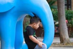 Little asian boy. Outdoor portrait of a little asian fat boy, Play in the park stock photos