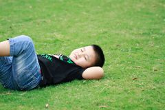 Little asian boy. Outdoor portrait of a little asian fat boy, Play in the park,Lying on the lawn and rest stock images
