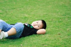 Little asian boy. Outdoor portrait of a little asian fat boy, Play in the park,Lying on the lawn and rest stock photography