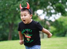 Little asian boy. Outdoor portrait of a little asian fat boy, Play in the park,running on the lawn royalty free stock photos