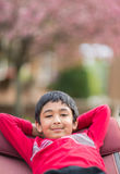 Outdoor Portrait of a Little Boy in a Hammock. In Spring Stock Photos