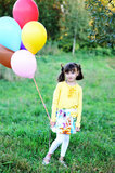 Outdoor portrait of little girl with balloons Stock Image