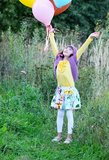 Outdoor portrait of little girl with balloons Royalty Free Stock Photos