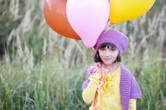 Outdoor portrait of little girl with balloons Stock Photography