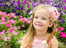 Outdoor portrait of little girl near the flowers Stock Image