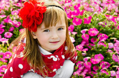 Outdoor portrait of little girl near the flowers Stock Photo