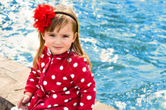 Outdoor portrait of little girl near the water Stock Photos