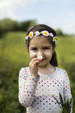 Outdoor portrait. Portrait of little girl who exploring nature and smelling flower Royalty Free Stock Photo