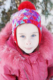 Outdoor portrait of a little pretty girl in winter park Stock Photos