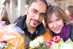 Outdoor portrait of man in glasses and blond girl Stock Photos