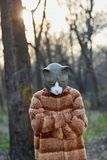 Outdoor portrait of man wearing sad cat costume. Outdoor portrait of man with arms crossed wearing miserable cat costume with mask Royalty Free Stock Images