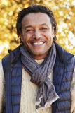 Outdoor Portrait Of Mature Man Wearing Scarf In Autumn Stock Image