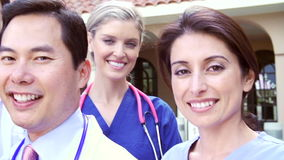 Outdoor Portrait Of Medical Team Outside Hospital stock footage