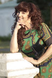 Outdoor portrait of the middle age woman. Stock Photo