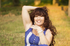 Outdoor portrait of the middle age woman. Royalty Free Stock Photography