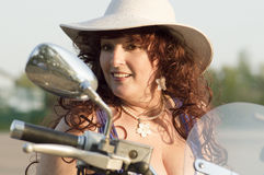 Outdoor portrait of the middle age woman on the motorcycle. Stock Photography