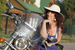Outdoor portrait of the middle age woman on the motorcycle. Royalty Free Stock Image