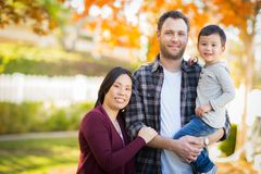 Outdoor Portrait of Mixed Race Chinese and Caucasian Parents and Stock Photography