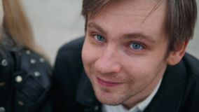 Outdoor portrait of modern young man with mobile phone in the street looking on camera. Outdoor portrait of modern young man with mobile phone in the street stock footage