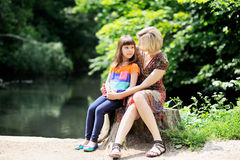 Outdoor portrait of mother and daughter Royalty Free Stock Images