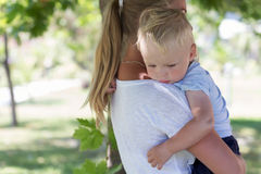 Outdoor portrait of mother and sad crying son in Stock Photo