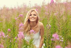 Free Outdoor Portrait Of A Middle Aged Blonde Woman. Attractive Sexy Girl In A Field With Flowers Royalty Free Stock Image - 142390806
